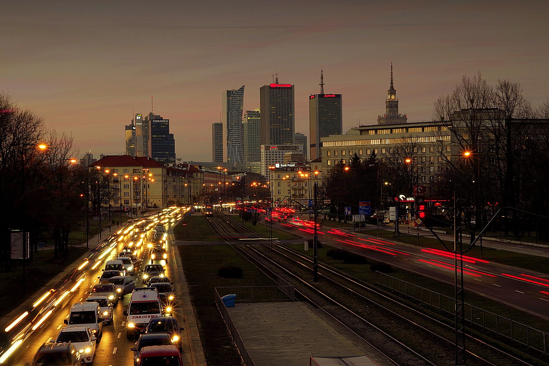 Image of a busy street with nighttime traffic in Warsaw.