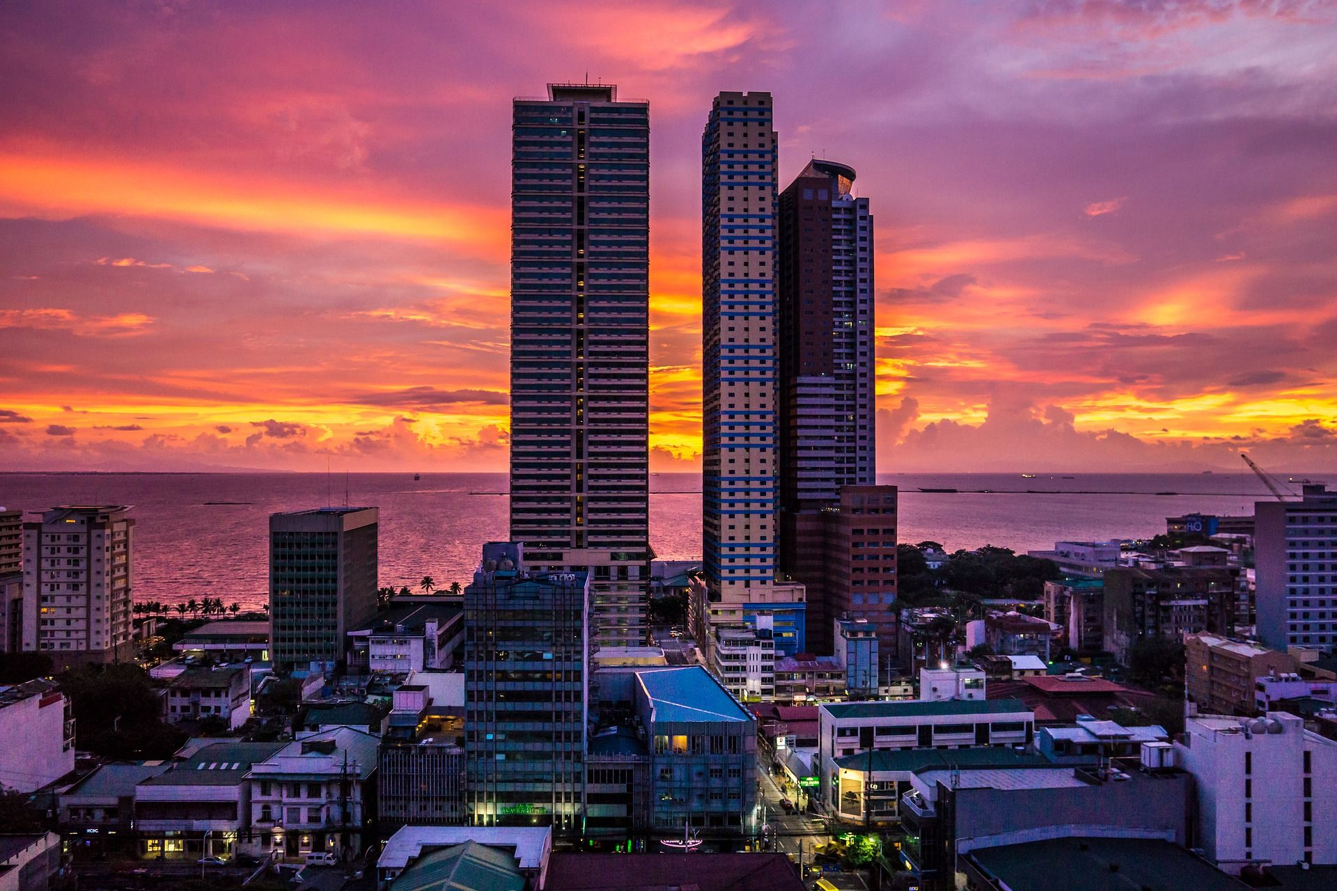 Image of high rises at sunset over Manila Bay